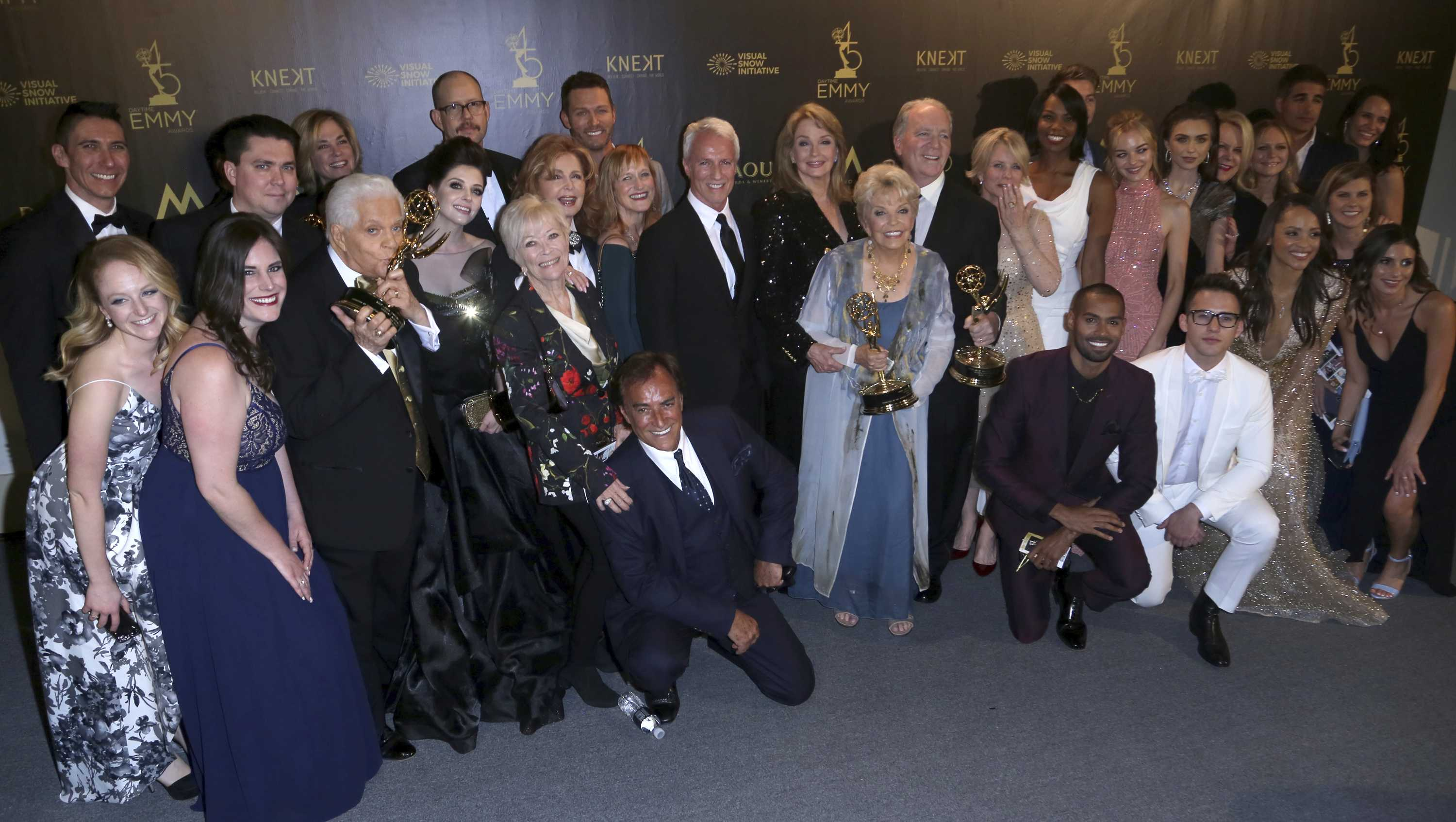 "The cast and crew of ""Days of Our Lives"" pose in the press room with the award for outstanding drama series at the 45th annual Daytime Emmy Awards at the Pasadena Civic Center on Sunday, April 29, 2018, in Pasadena, Calif."