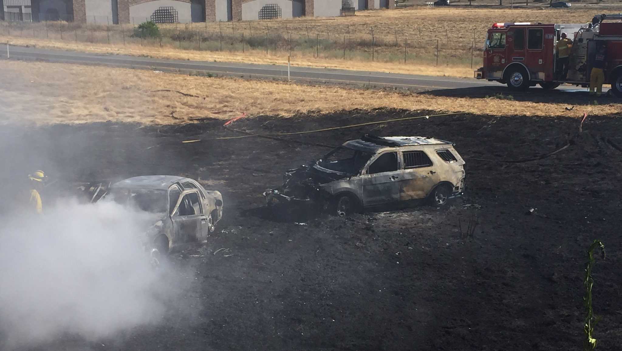 Firefighters work to contain a fire on Tuesday, June 20, 2017, after a police chase ended in a Vacaville field near Interstate 505, officials said.