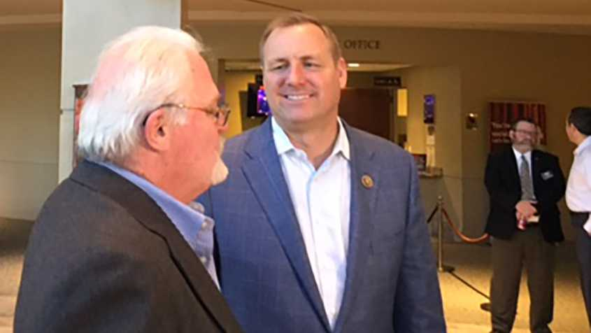 Rep. Jeff Denham talks with constituents on Wednesday, April 19, 2017, in Modesto during a Chamber of Commerce luncheon.