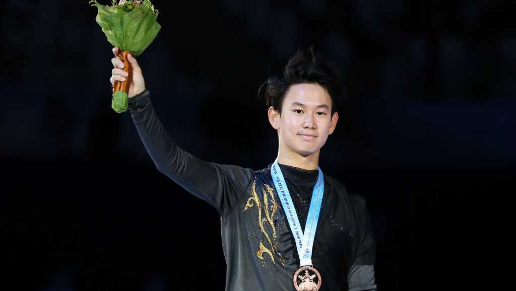 Bronze medalist Denis Ten of Kazakhstan looks on in the victory ceremony for men free skating during the 2017 Shanghai Trophy at the Oriental Sports Center on November 25, 2017 in Shanghai, China.