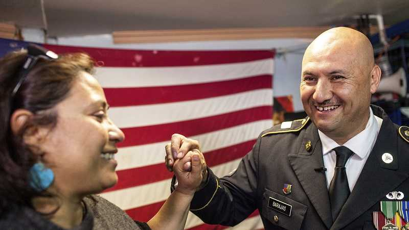 Hector Barajas-Varela, a deported U.S. Army veteran, right, celebrates with Norma Chavez-Peterson, executive director of the ACLU of San Diego and Imperial counties, after Barajas-Varela was delivered an announcement granting his American citizenship in Tijuana, Mexico, Thursday, March 29, 2018.