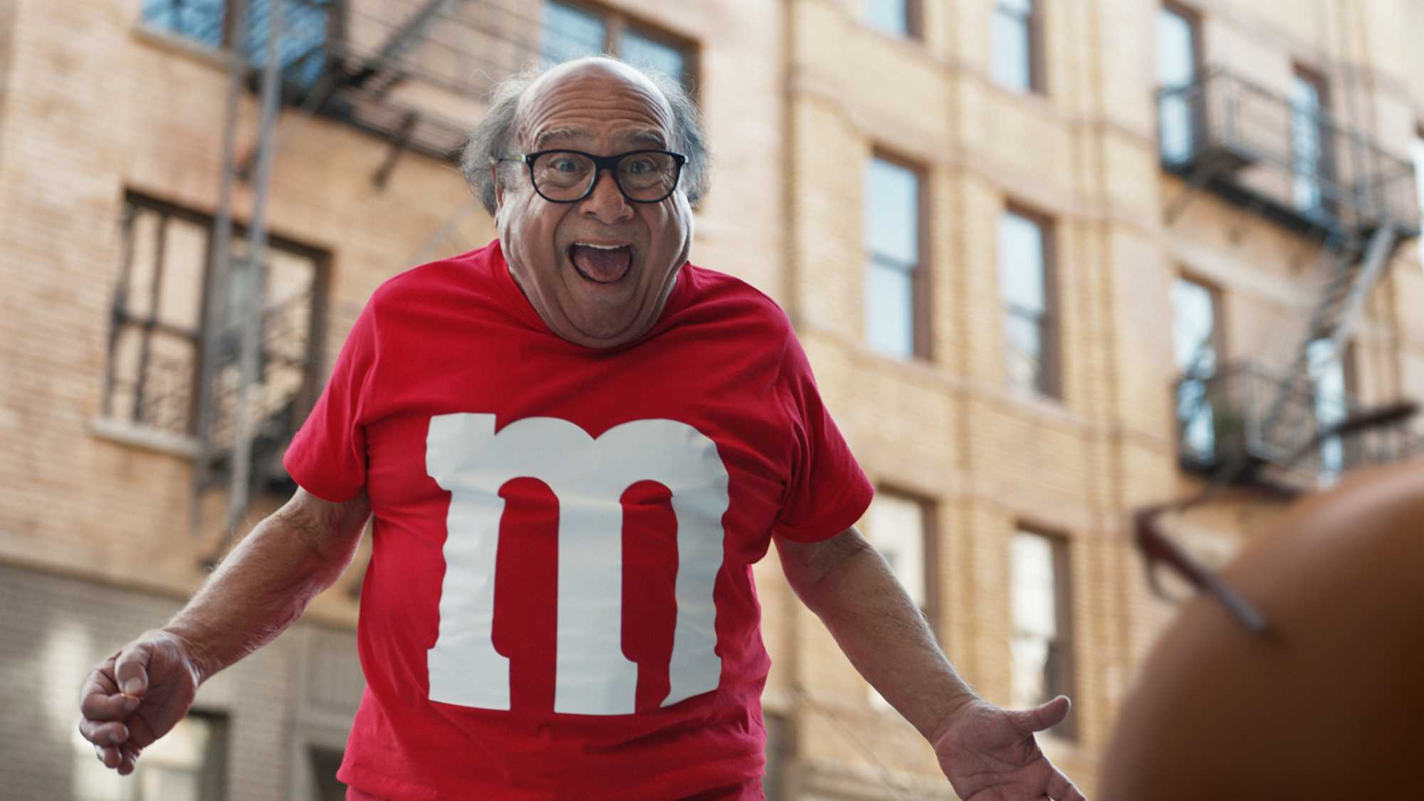 This photo provided by M&M's shows a scene from the company's Super Bowl spot, featuring actor Danny DeVito.