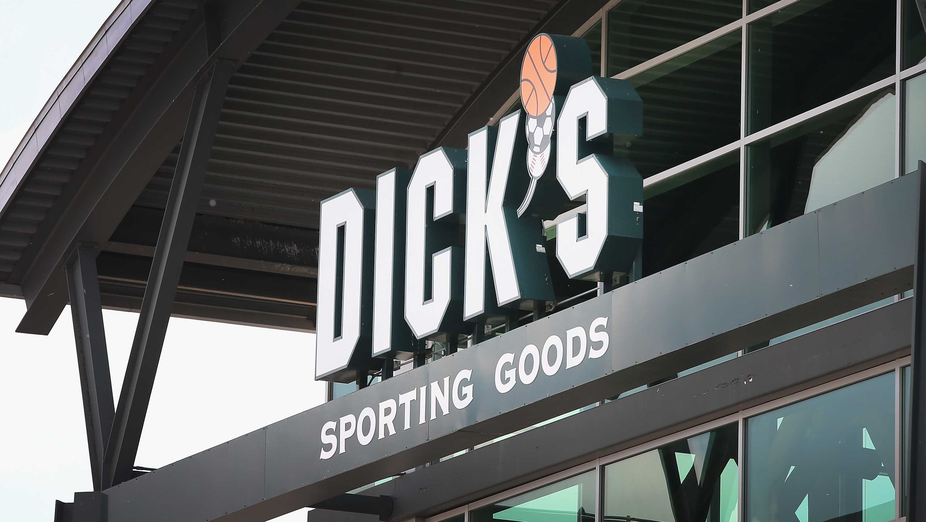 A sign with the company logo hangs above the entrance of a Dick's Sporting Goods store on May 20, 2014 in Niles, Illinois. Dicks Sporting Goods stock price plummeted more than 17% during mid-day trading today following a weaker than expected earnings announcement.