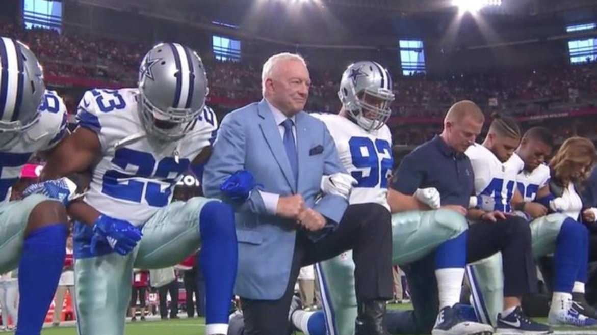Dallas Cowboys, including owner, link arms, kneel before national anthem