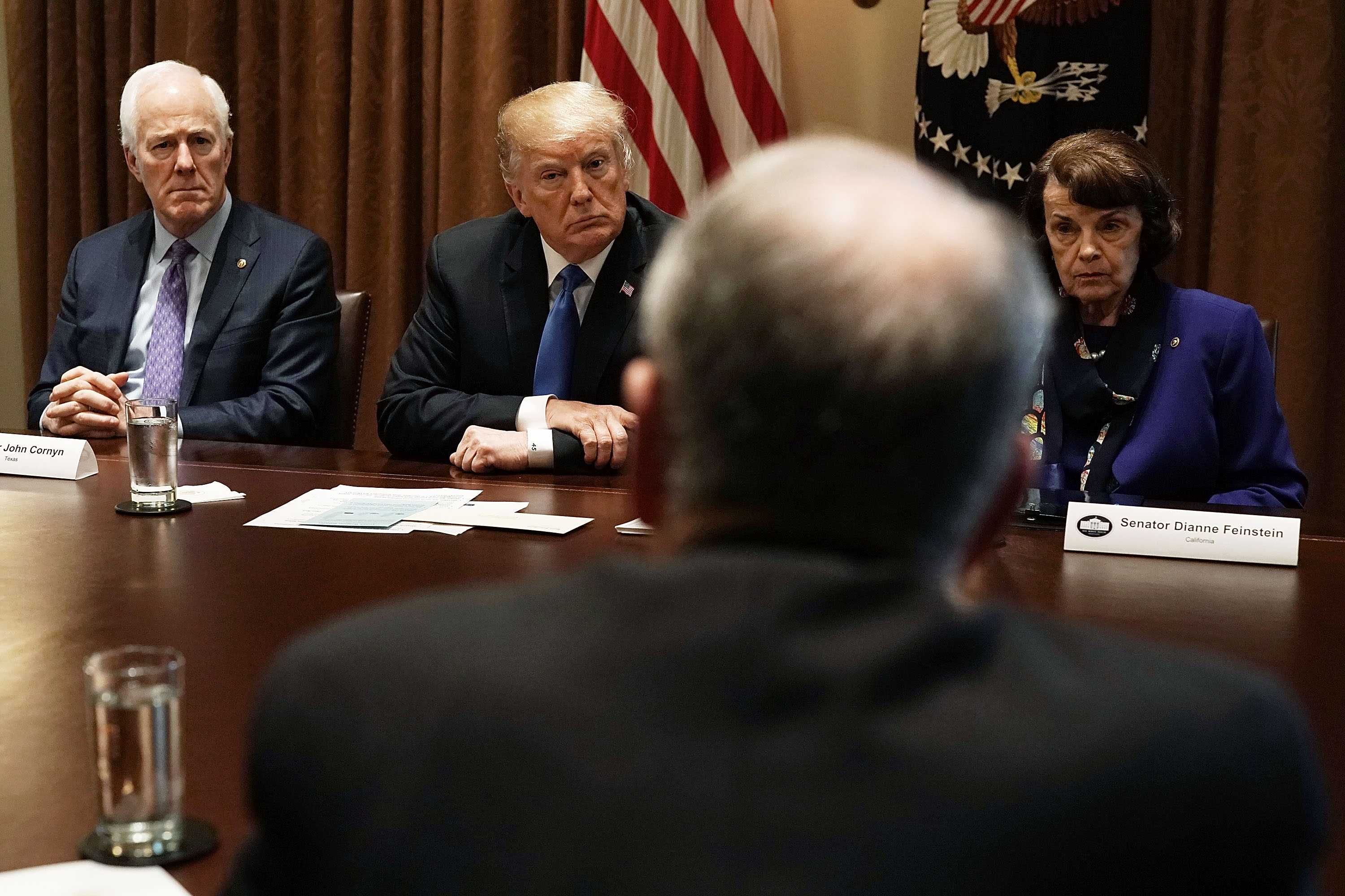 U.S. President Donald Trump, Senate Majority Whip Sen. John Cornyn  and Sen. Dianne Feinstein  listen during a meeting with bipartisan members of the Congress at the Cabinet Room of the White House