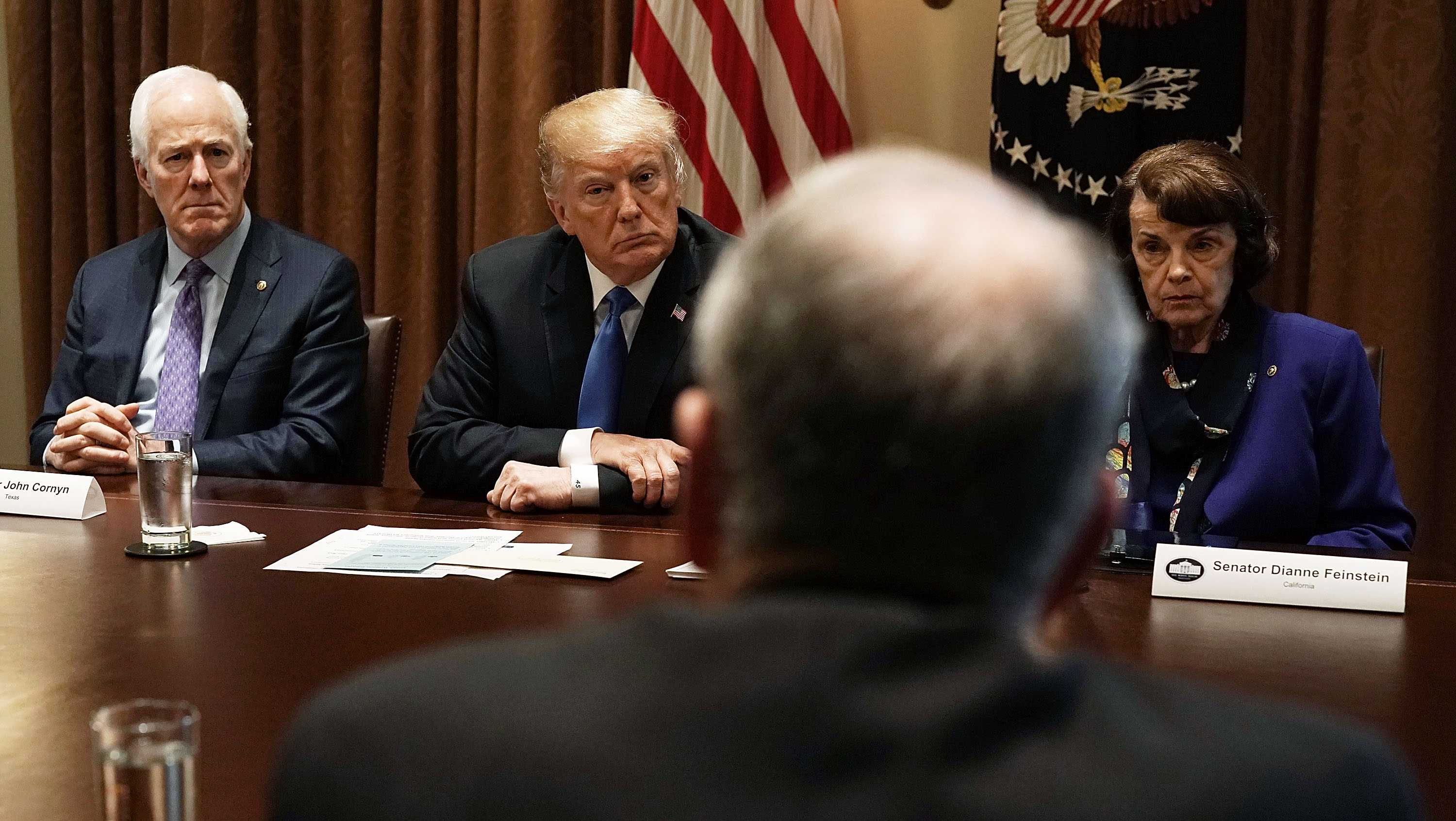U.S. President Donald Trump (2nd L), Senate Majority Whip Sen. John Cornyn (R-TX) (L) and Sen. Dianne Feinstein (D-CA) (R) listen during a meeting with bipartisan members of the Congress at the Cabinet Room of the White House February 28, 2018 in Washington, DC.
