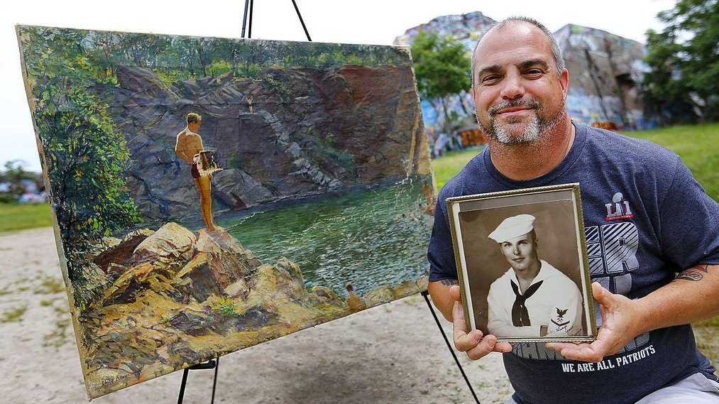 """Doug Henry holds a picture of his father, Norman """"Scottie"""" Henry, who's depicted in a 1939 painting"""