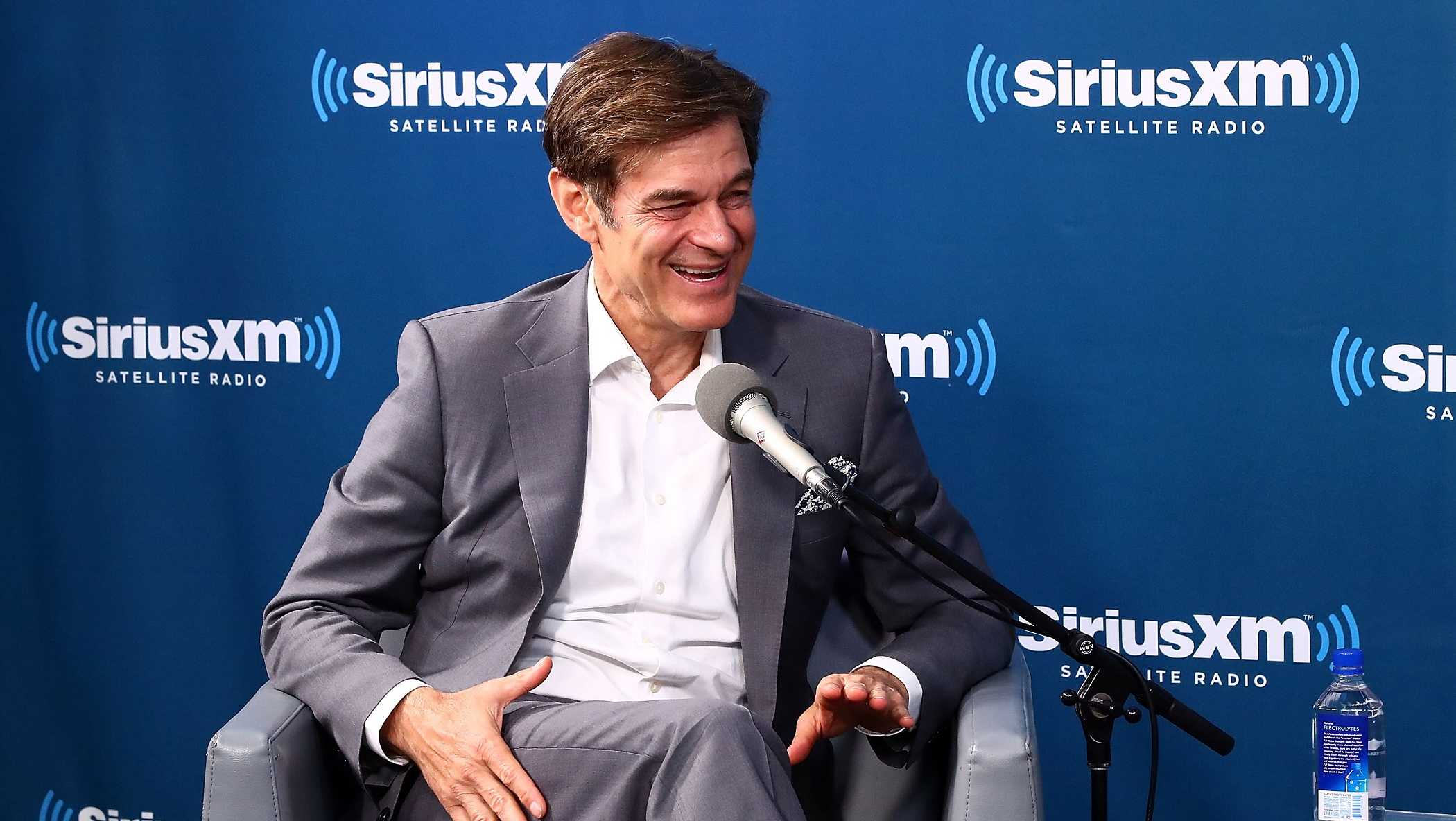 Dr. Mehmet Oz talks with SiriusXM host Jenny McCarthy at the SiriusXM Studios on April 9, 2018 in New York City.