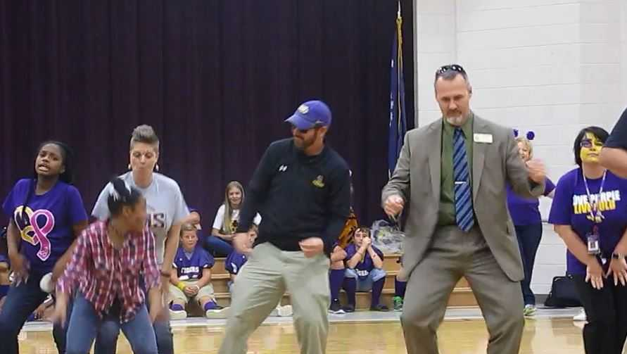 Dr. Roach dances with student