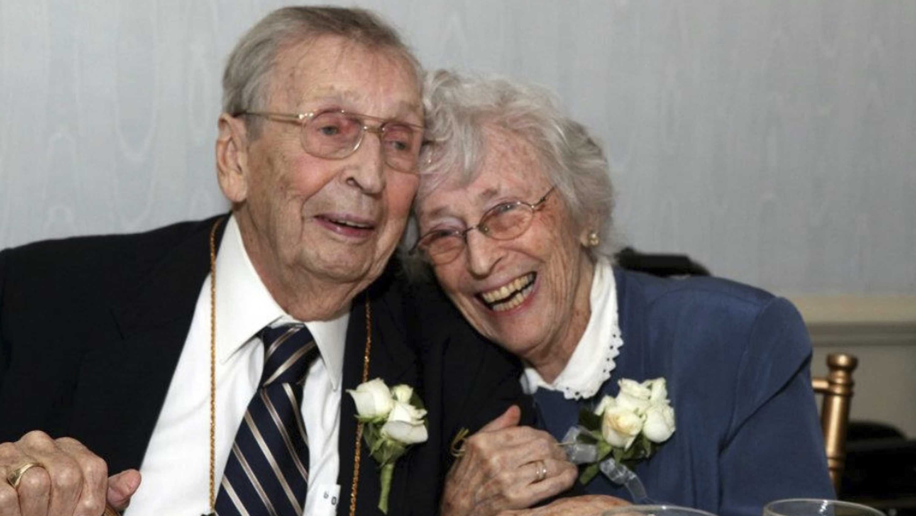 This Sept. 24, 2011 photo provided by Elizabeth Officer shows her grandparents Gilbert Orzell Drake and Evelyn Bennett Drake at the Albany Country Club in Albany, N.Y. The couple, born two years and two days apart and married 78 years, has died within two days of each other. According to their family, 98-year-old Evelyn died July 20, 2018, and her 100-year-old husband Gilbert passed away two days later. Both died of natural causes with their family by their sides at the couple's home in Delmar, an Albany suburb.