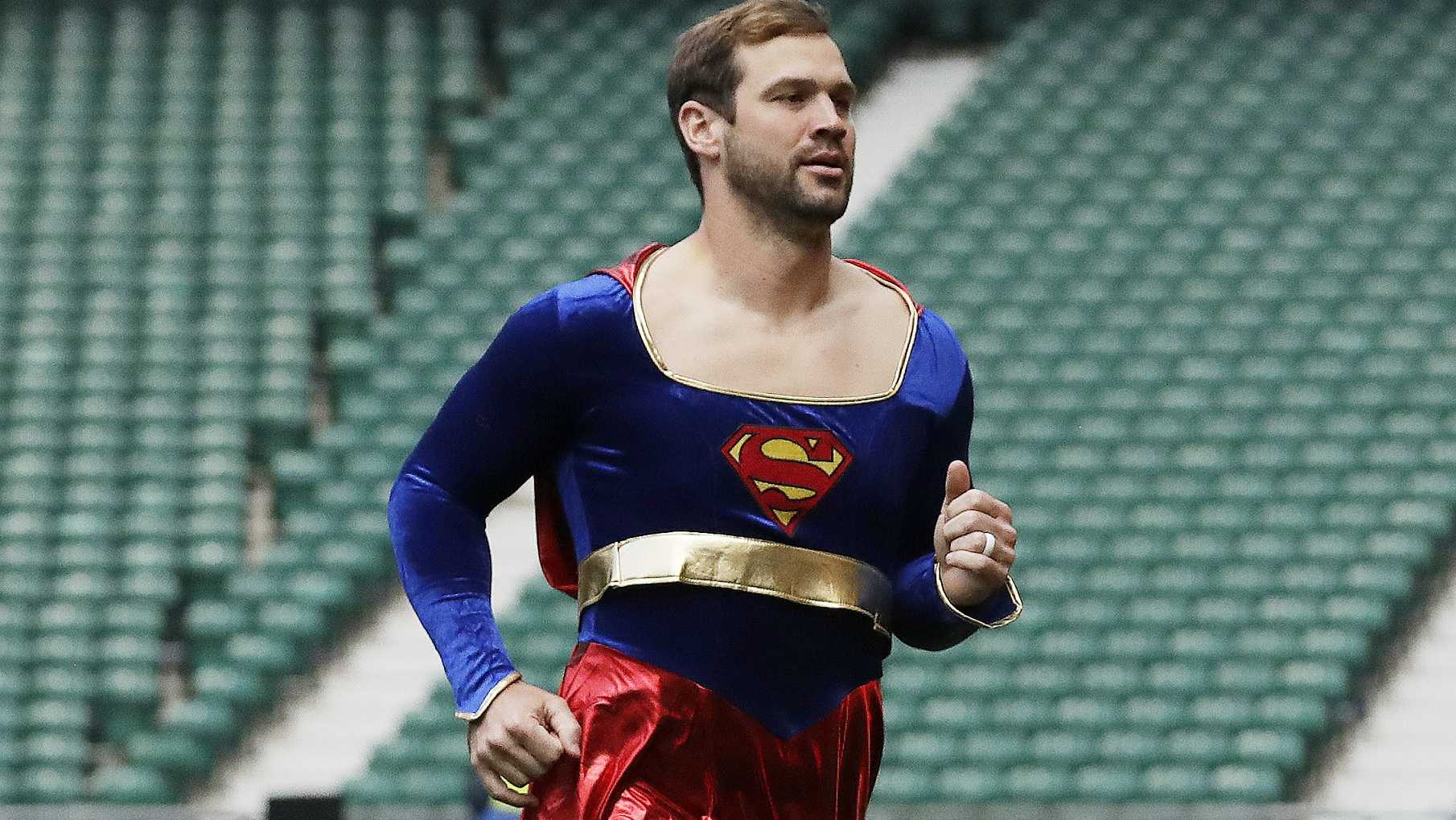 "Arizona Cardinals quarterback Drew Stanton does a somersault on the field dressed as ""Supergirl"" before an NFL football game against Los Angeles Rams at Twickenham Stadium in London, Sunday Oct. 22, 2017."
