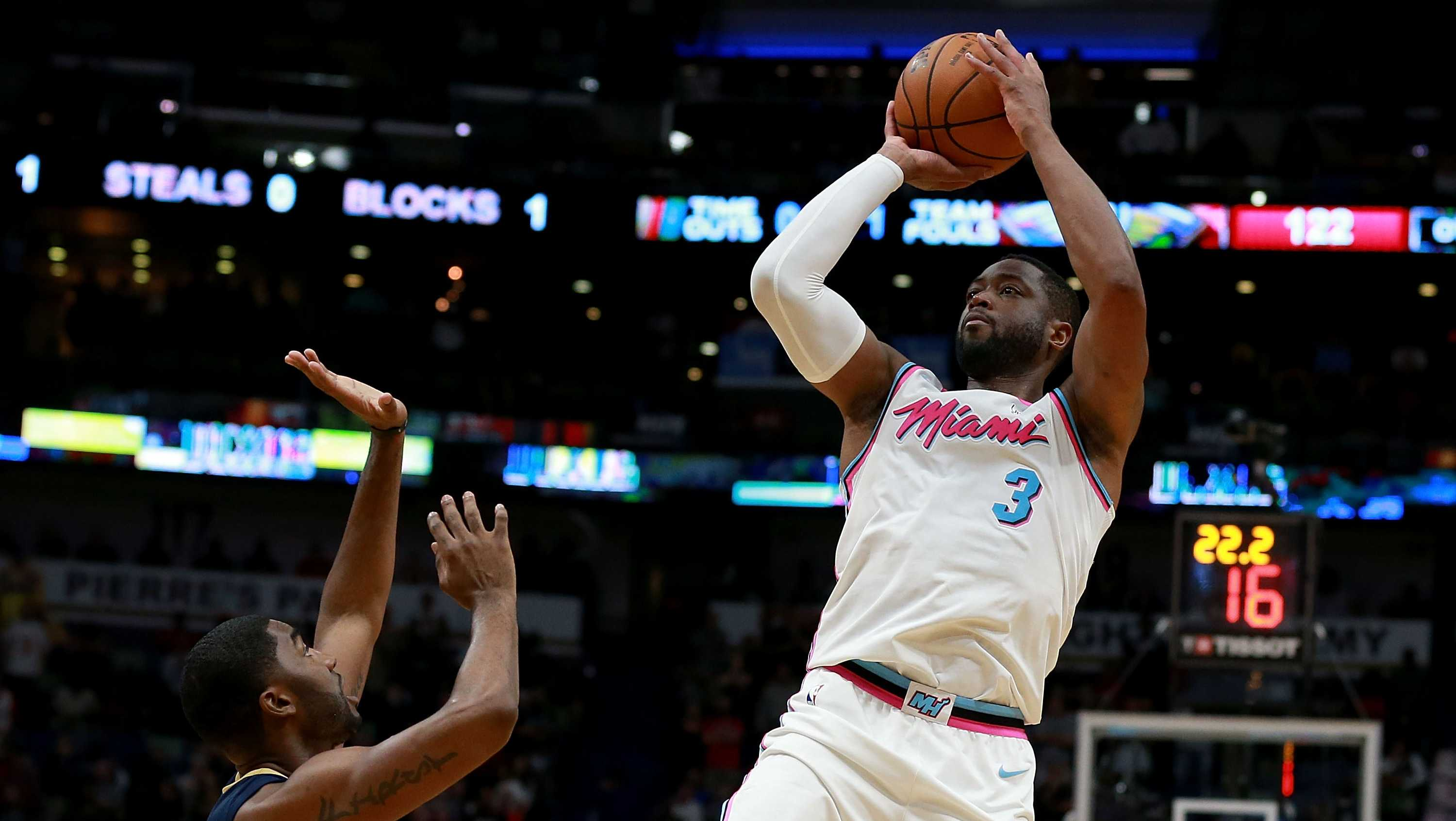 Dwyane Wade #3 of the Miami Heat shoots over Darius Miller #21 of the New Orleans Pelicans during a NBA game at the Smoothie King Center on February 23, 2018 in New Orleans, Louisiana