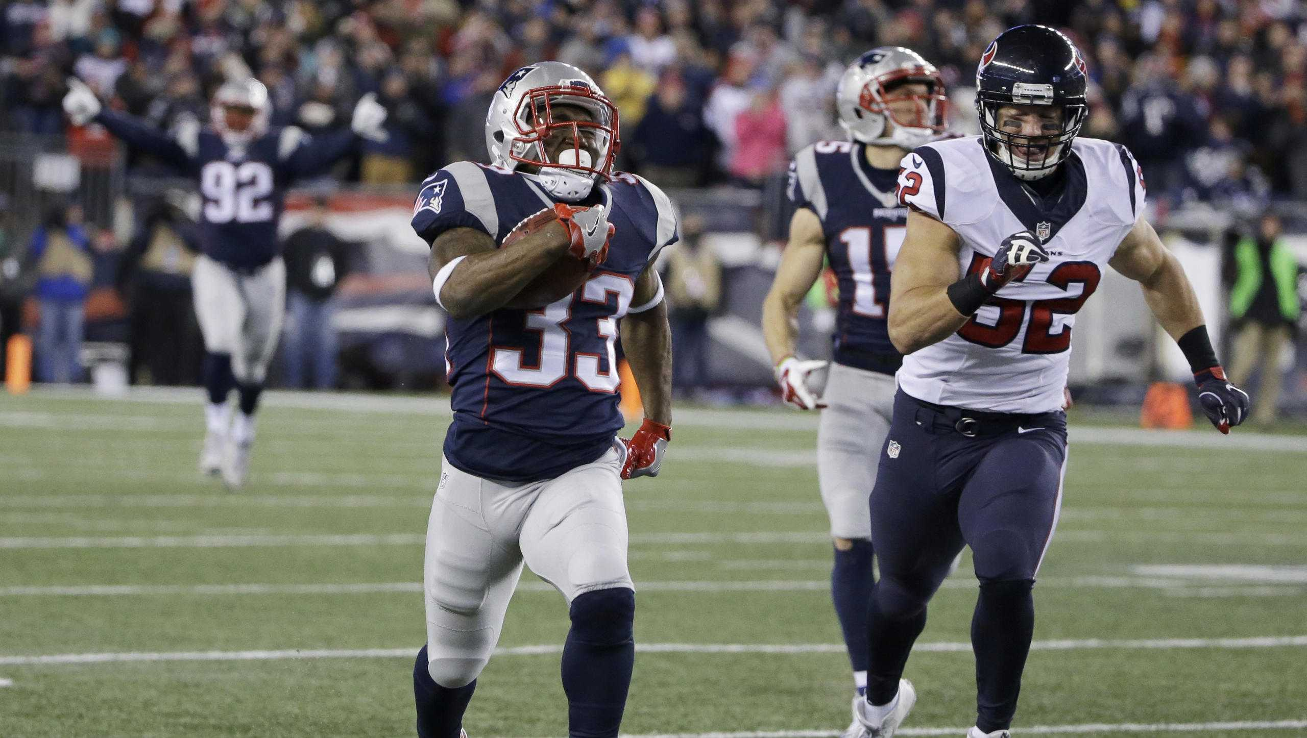 New England Patriots running back Dion Lewis (33) runs ahead of Houston Texans linebacker Brian Peters (52) for a touchdown during the first half of an NFL divisional playoff football game, Saturday, Jan. 14, 2017, in Foxborough, Mass. (AP Photo/Elise Amendola)