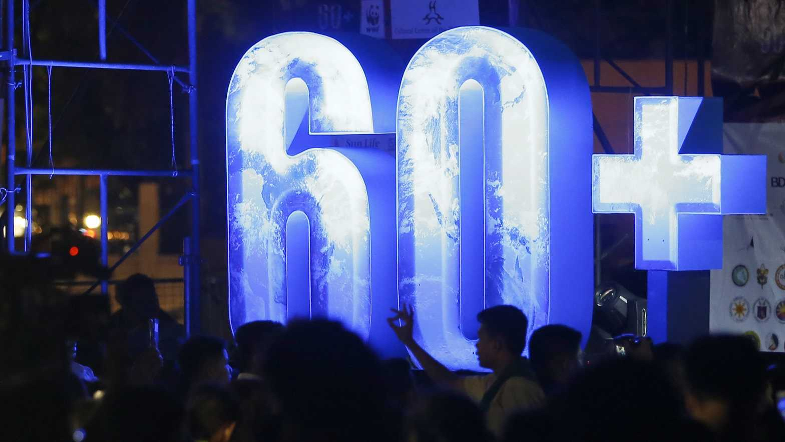 Filipinos gather at the Cultural Center of the Philippines to take part in an Earth Hour activity, a global even that raises awareness on the need to take action on climate change Saturday, March 24, 2018 in suburban Pasay city southeast of Manila, Philippines.