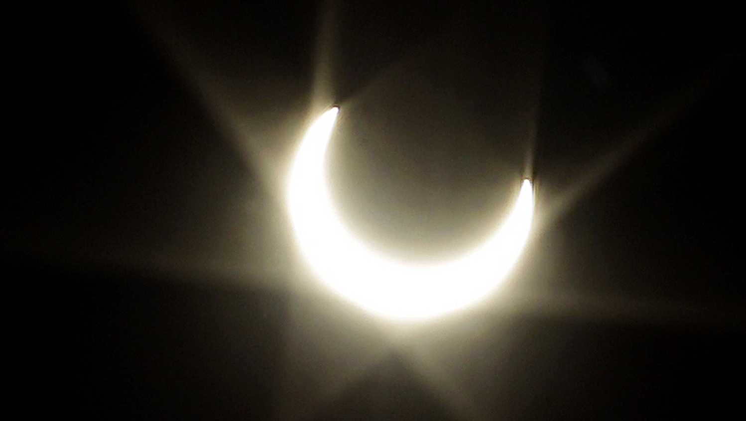 In this May 20, 2012 photo, the annular solar eclipse produces a flare through a lens in Alameda, Calif.