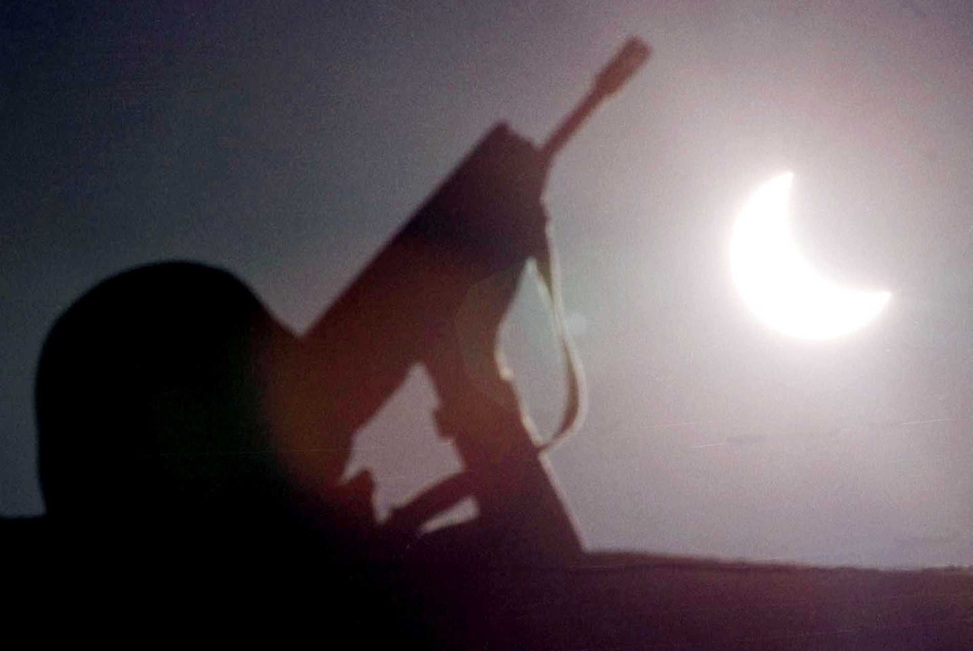 A French soldier, part of NATO's peacekeeping forces in Kosovo, stands guard beneath the solar eclipse on the ethnic Albanian side of the bridge dividing Kosovska Mitrovica, about 20 miles north of Pristina, Yugoslavia on August 11, 1999.