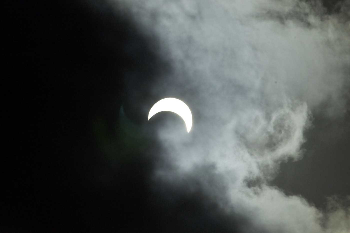 A crescent sun is seen as the marine layer moves by during a partial solar eclipse on June 10, 2002, in San Diego.