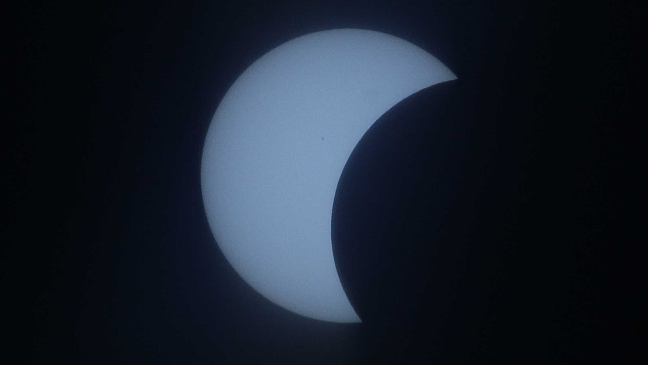 ​A partial solar eclipse occurs on March 9, 2016, as seen from Quezon city, north of Manila, Philippines.