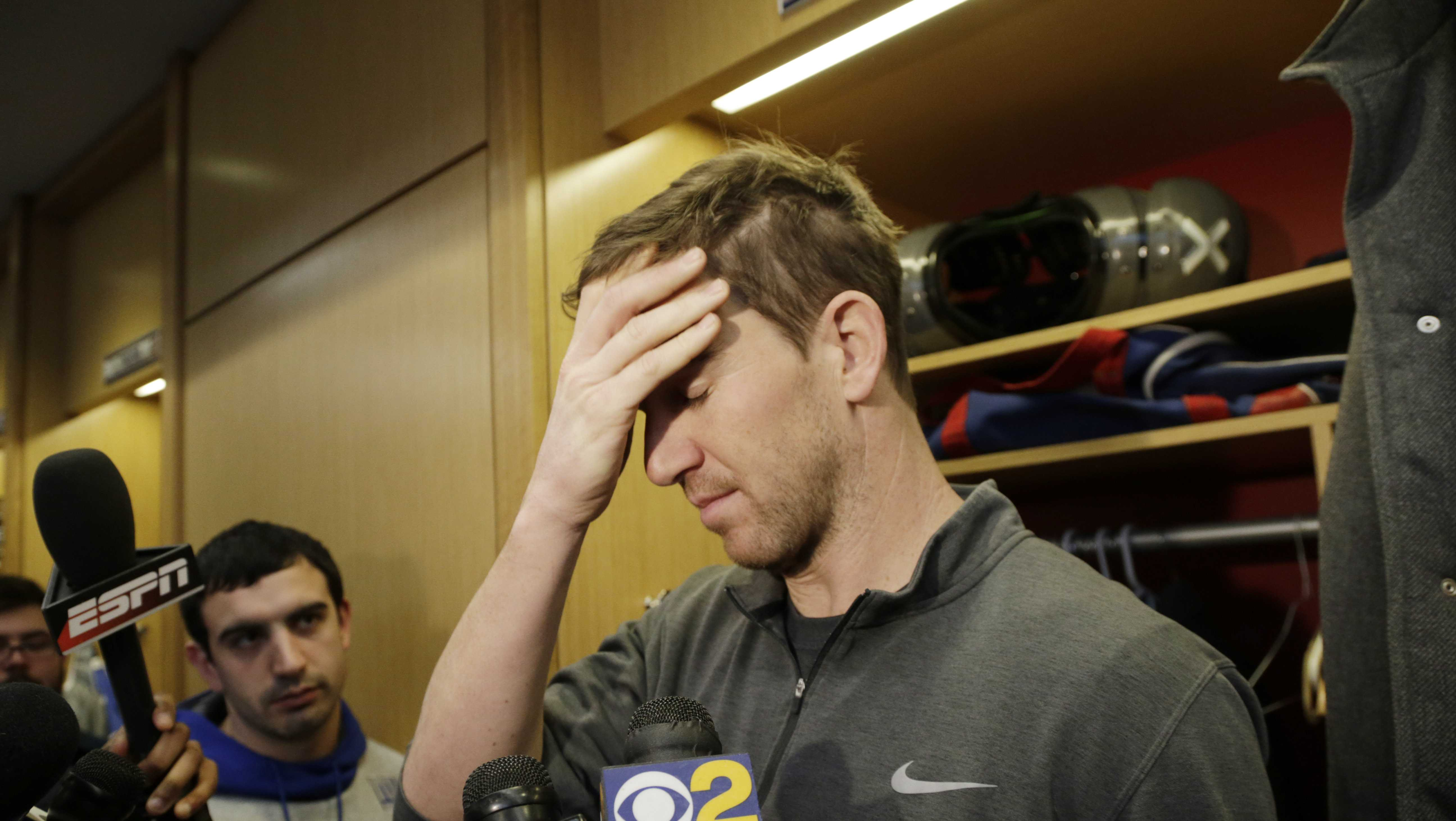 New York Giants quarterback Eli Manning gestures while speaking to reporters in the locker room in East Rutherford, N.J., Monday, Jan. 9, 2017.
