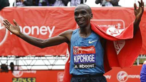 Eliud Kipchoge of Kenya celebrates after he wins the Men's race in the 35th London Marathon, Sunday, April 26, 2015.