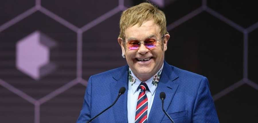 British singer Sir Elton John delivers a speech after receiving a Crystal Award from the hands of Schwab Foundation for Social Entrepreneurship Chairperson and Co-Founder during a ceremony ahead of the World Economic Forum (WEF) 2018 annual meeting, on January 22, 2018 in Davos, eastern Switzerland.