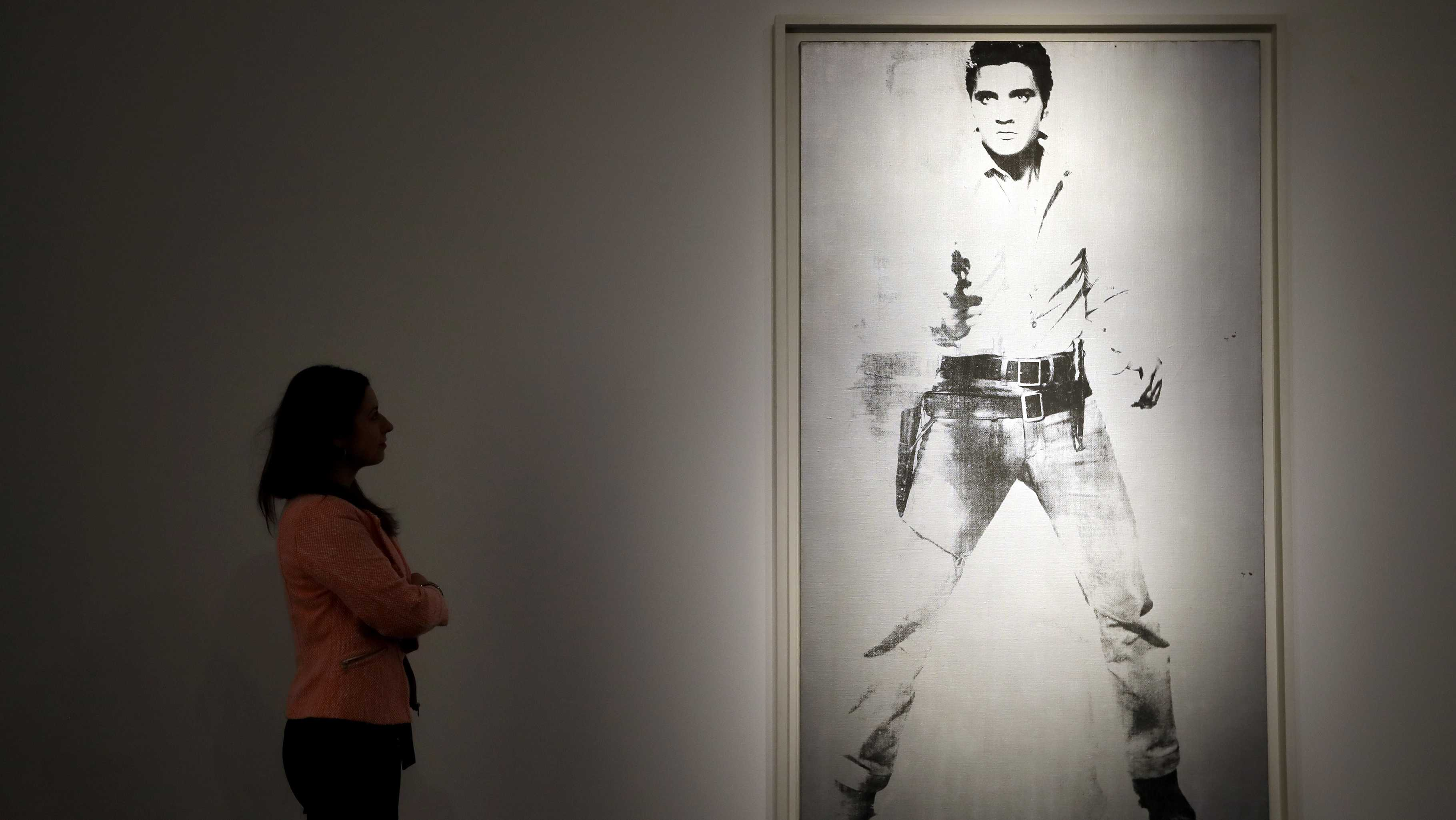 A painting by Andy Warhol called 'Double Elvis [Ferus Type]' (1963) is displayed at Christie's auction rooms in London, Thursday, April 5, 2018. The painting will be offered in the Post-War and Contemporary Art Evening Auction in New York on May 17, and carries a price tag around $30 million.