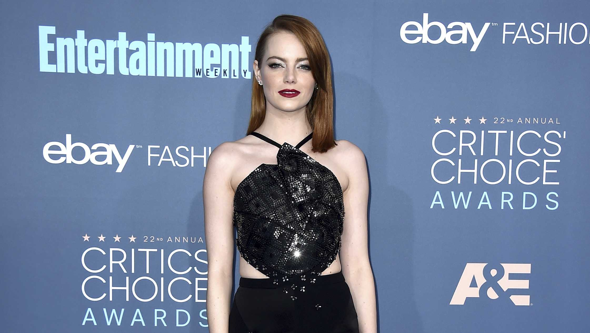 Emma Stone arrives at the 22nd annual Critics' Choice Awards at the Barker Hangar on Sunday, Dec. 11, 2016, in Santa Monica, Calif.