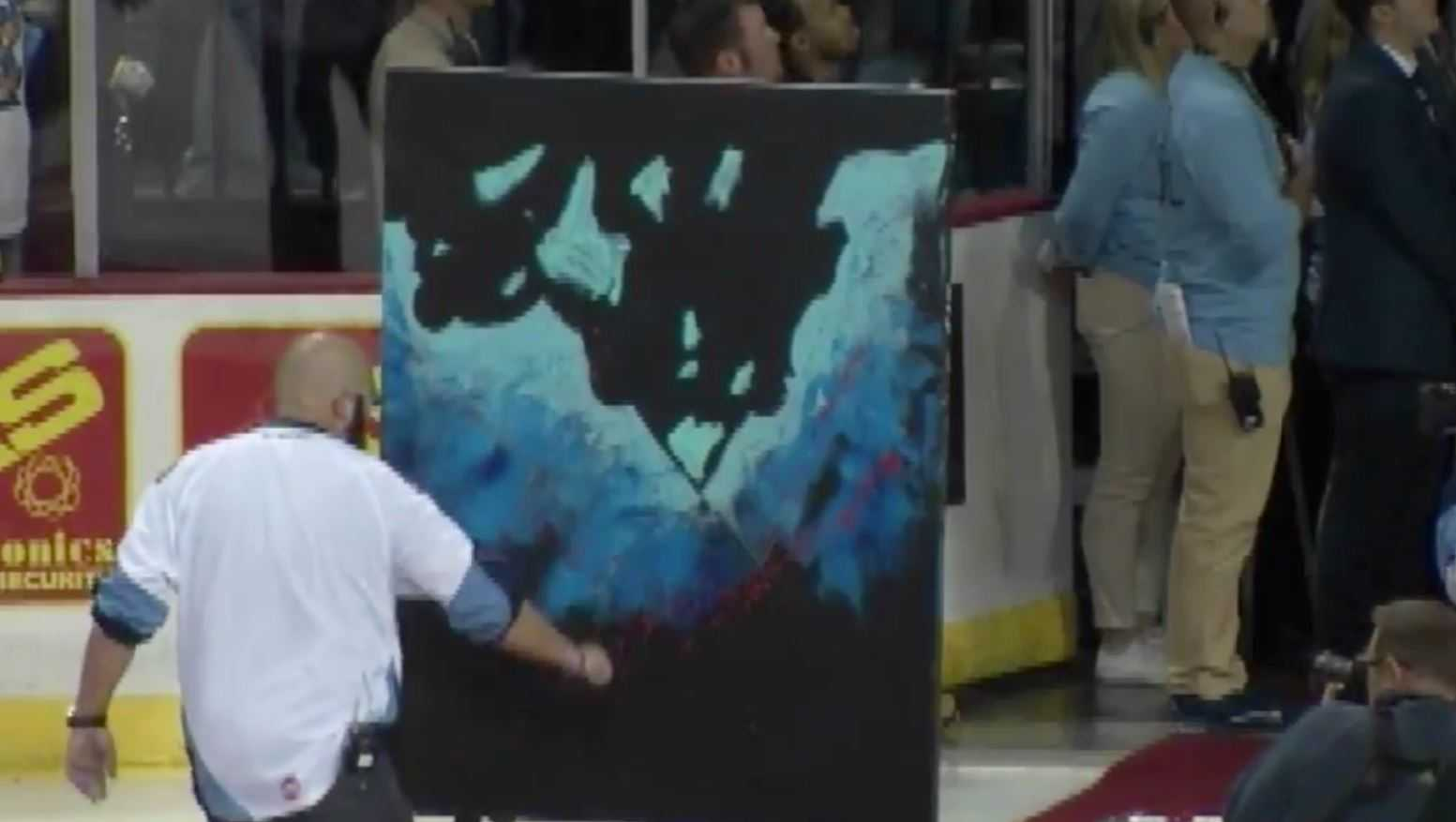 Jo Everson sings national anthem while painting