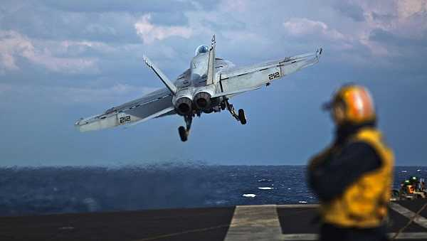 An F-18E Super Hornet assigned to the Royal Maces of Strike Fighter Squadron (VFA) 2 launches off the flight deck of the Nimitz-class aircraft carrier USS George Washington (CVN 73).