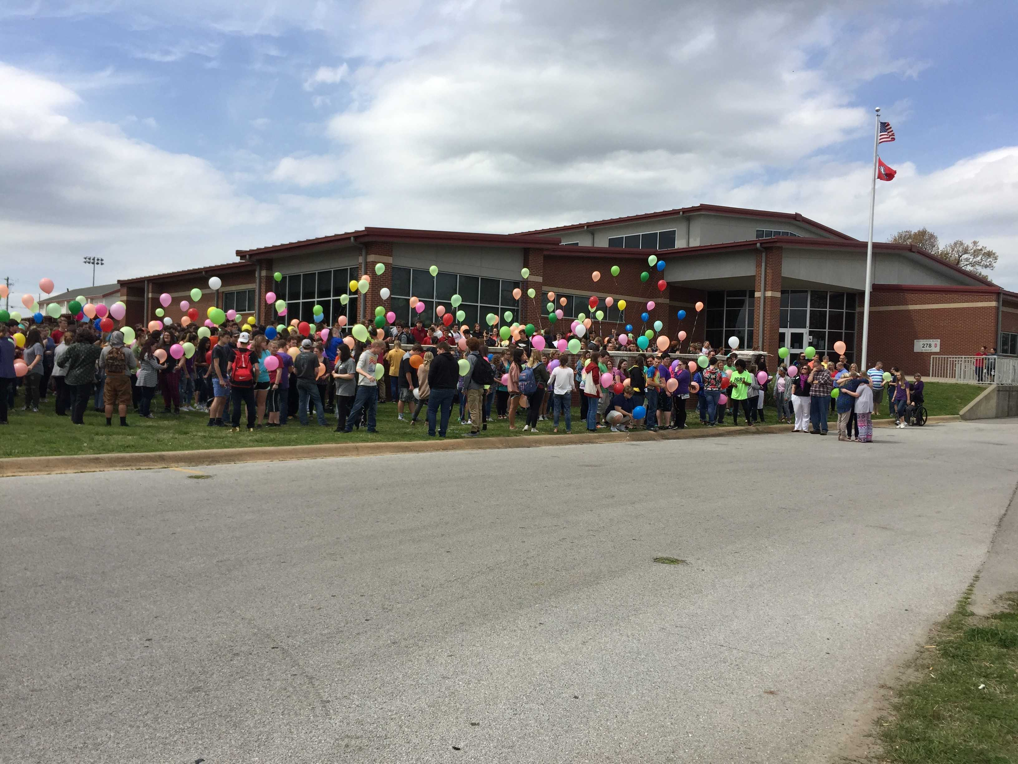 Farmington High School students and staff release balloons to remember Isaac Cartwright