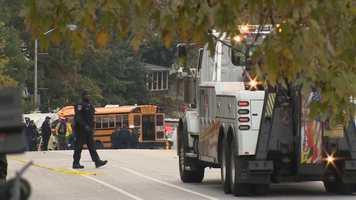 City crews work to clean up the scene of an accident where a school bus and an MTA bus collided.
