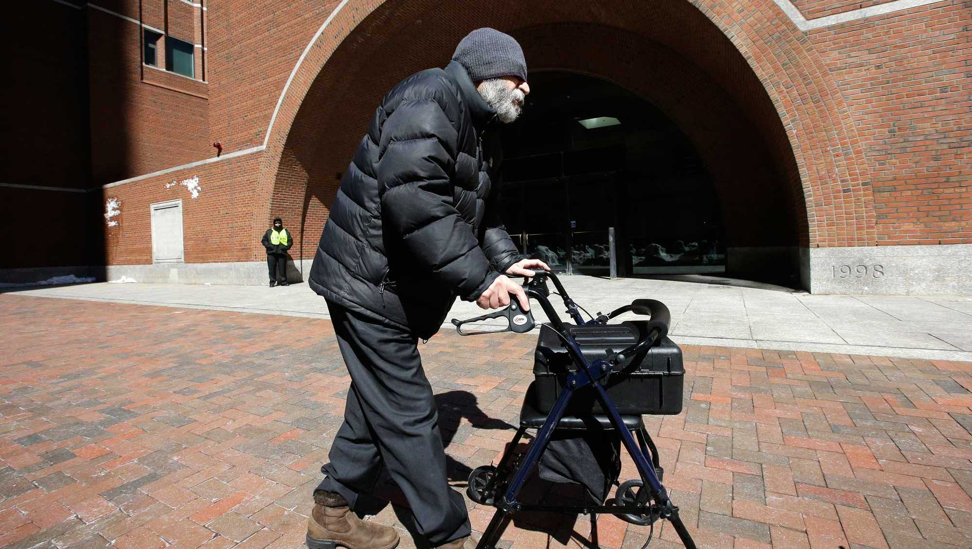 Dr. Fathalla Mashali departs federal court Wednesday, March 15, 2017, in Boston, after pleading guilty to multiple counts of health care fraud. Prosecutors said Mashali often saw more than 100 patients a day and would write prescriptions for oxycodone and other opioids without doing physical exams or medical tests to determine whether patients had a legitimate medical condition that required powerful painkillers.