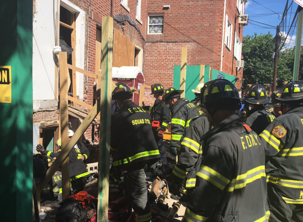 2 workers trapped after roof collapses in New York City