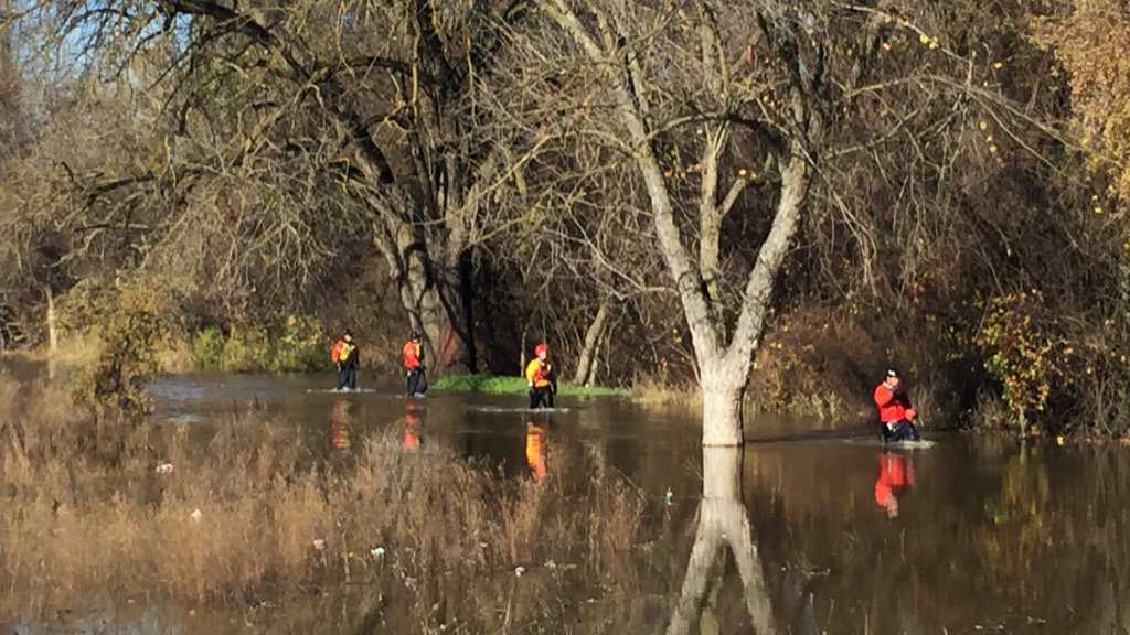 Sacramento firefighters look for a dog stranded in the American River on Sunday, Dec. 18, 2016.