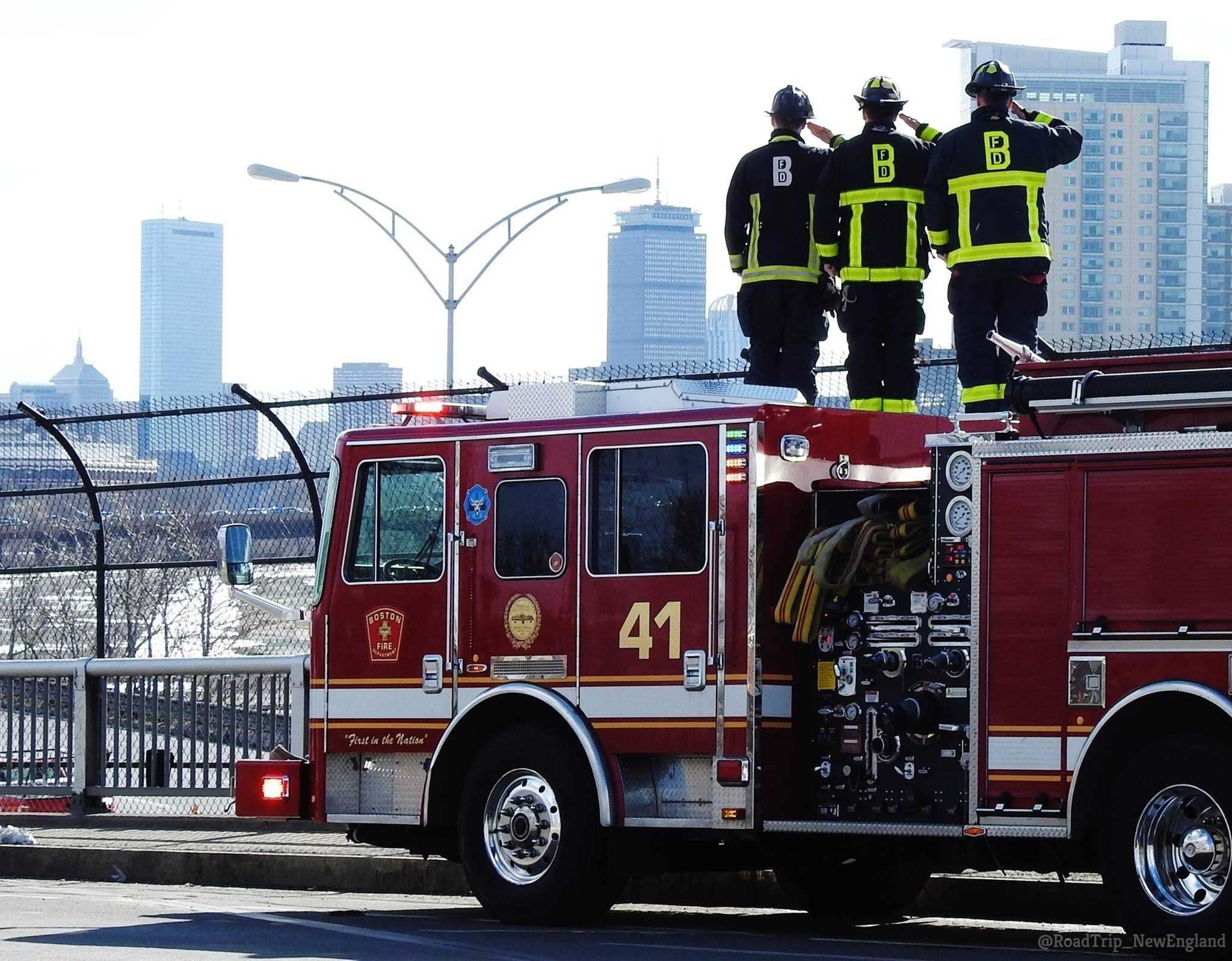 Boston firefighters salute the procession for Watertown firefighters Joe Toscano
