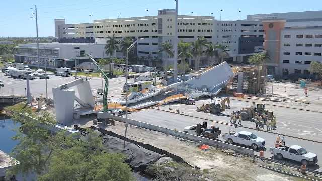 Drone footage shows the aftermath of the Florida International University pedestrian bridge collapse