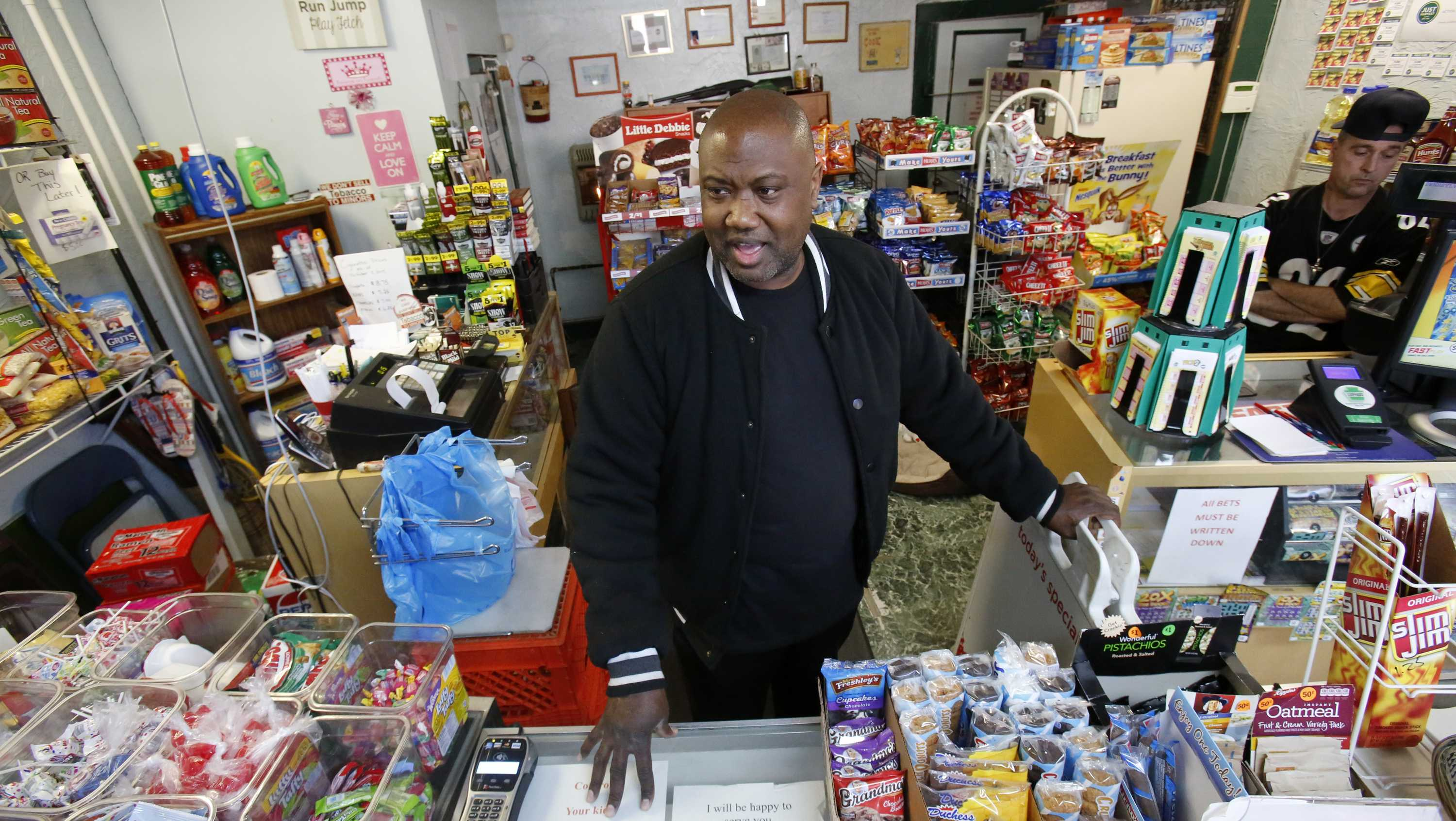 In this Feb. 26, 2018, file photo, Carl Lewis in his market in Rankin, Pa. About half of Lewis' customers pay with benefits from the federal Supplemental Nutrition Assistance Program, so the government's proposal to replace the debit card-type program with a pre-assembled box of shelf-stable goods delivered to recipients worries him and other grocery operators in poor areas.