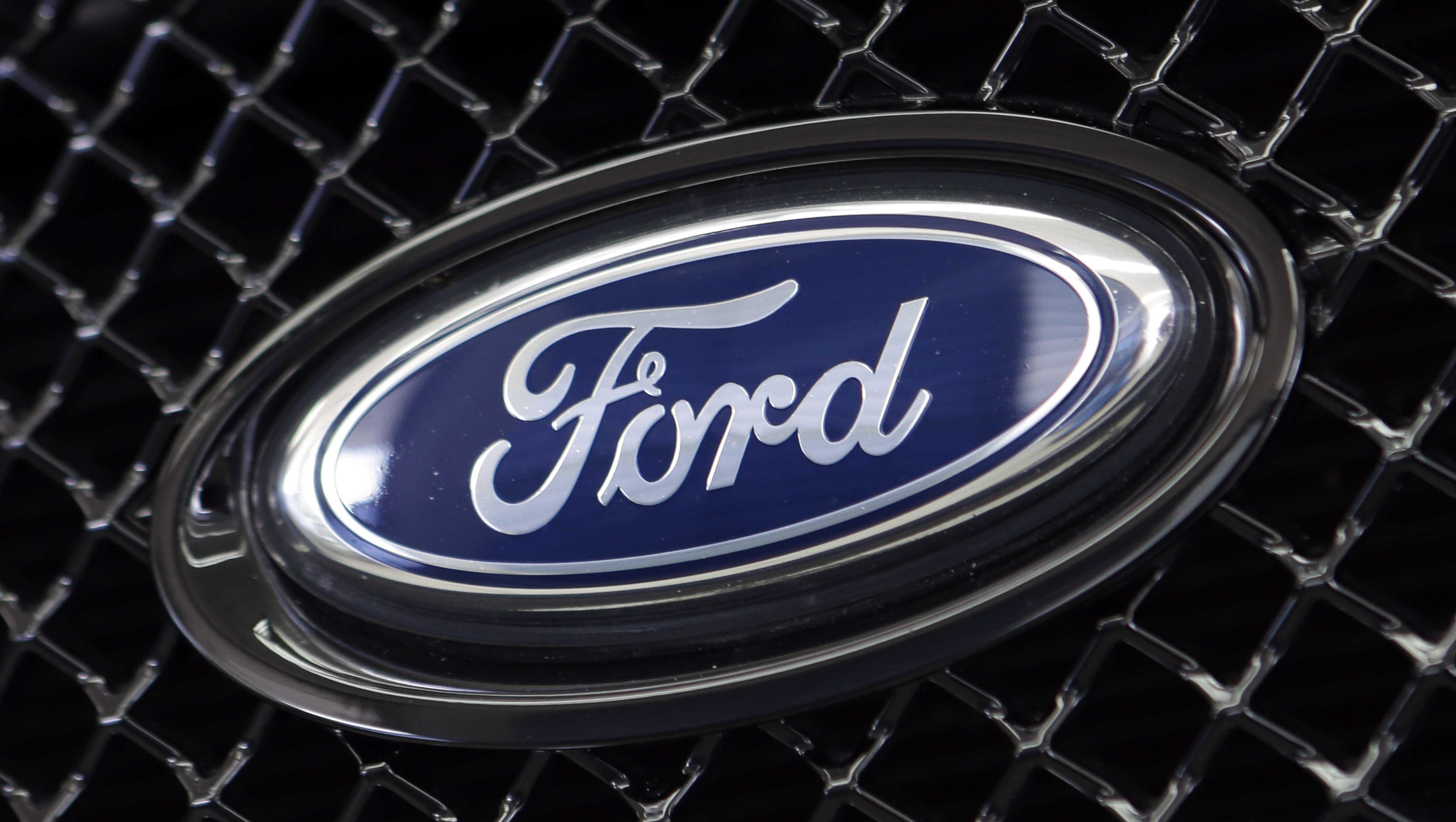 This Aug. 21, 2014 file photo shows the Ford logo on a vehicle at a dealership in Hialeah, Fla.