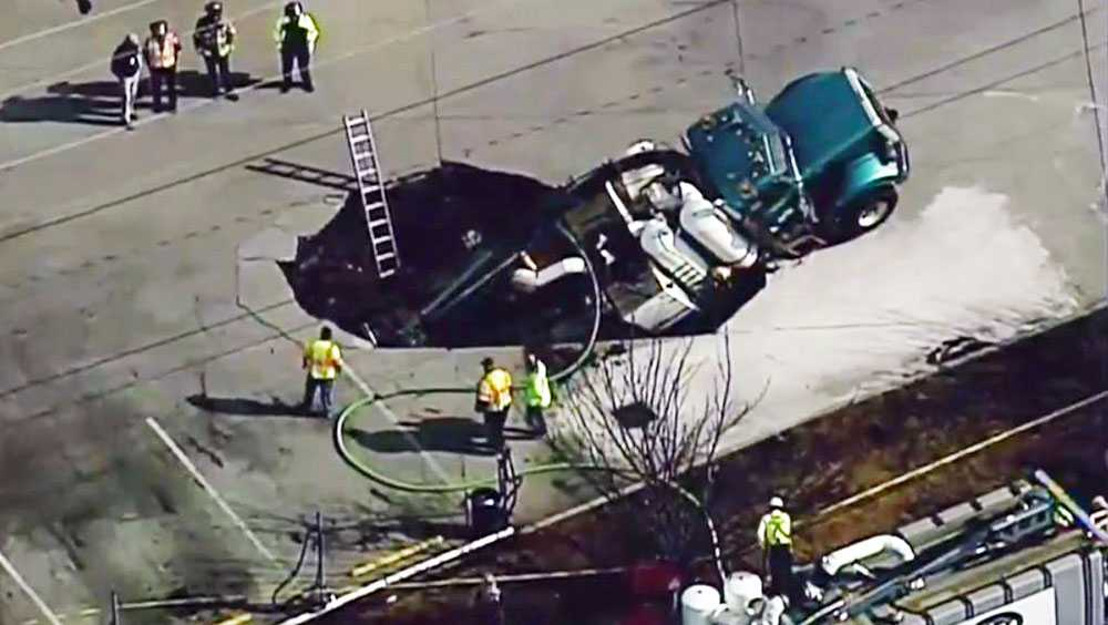 What appears to be an 18-wheeler falls into sinkhole in Oakwood, Ga.