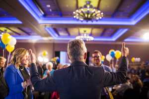 Libertarian presidential candidate Gary Johnson greets people at his election night party.