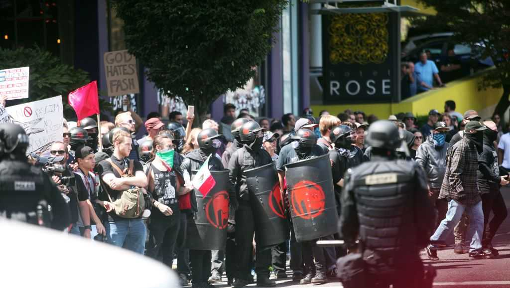 Image result for Photo: Mike Bivins Police in Portland, Oregon declared a civil disturbance on Saturday after counter-protesters from…