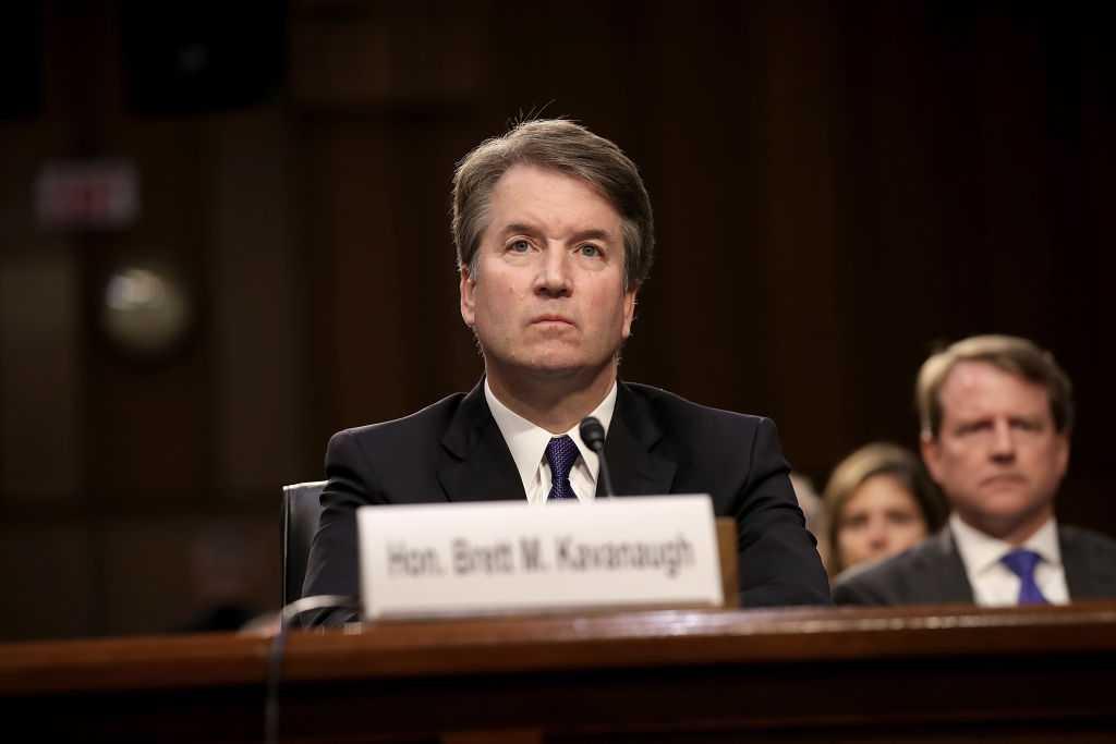 Brett Kavanaugh awaits fate as senators read FBI report