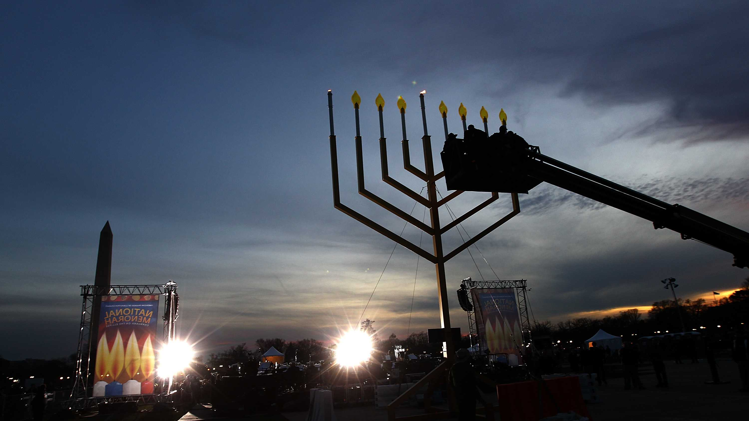 The National Menorah is lit for the first night of Hanukkah on the National Mall December 20, 2010 in Washington DC. Hanukkah, also known as the Festival of Lights, is an eight day Jewish holiday marking the rededication of the Holy Temple in Jerusalem. (Photo by Win McNamee/Getty Images)
