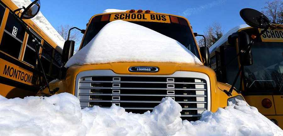 Montgomery County Public School buses remained idle as schools were closed Jan. 25, 2016, in Bethesda, Maryland.