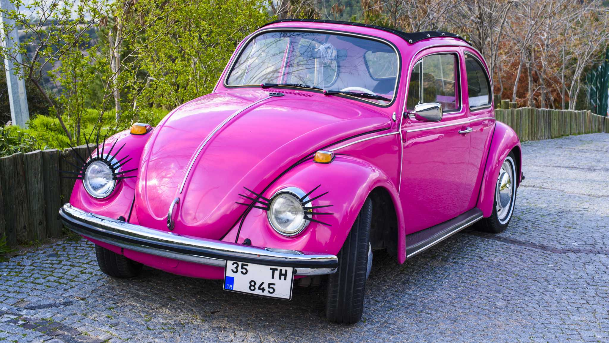 Izmir, Turkey, March 16, 2016: Old fashioned car parked next to the garden in Izmir. The Volkswagen Type 1, widely known as the Volkswagen Beetle, was an economy car produced by the German auto maker Volkswagen (VW) from 1938 until 2003