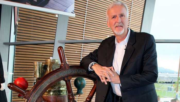 Titanic director James Cameron with the donated ship's wheel from the movie, at the Titanic Belfast Museum where he unveiled the opening of a special exhibition in honor of the Academy Award winning film.