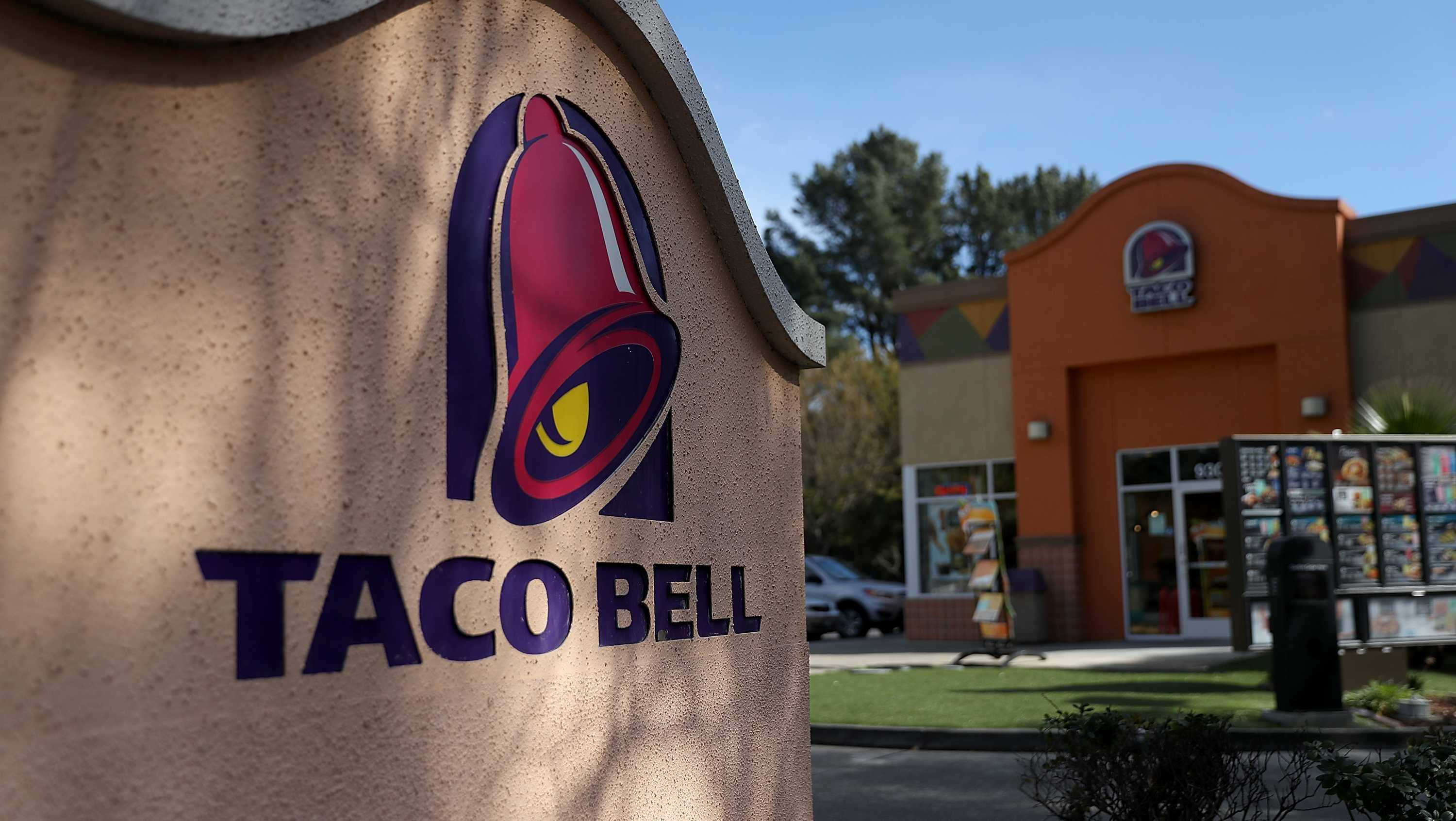 A sign is posted in front of a Taco Bell restaurant on February 22, 2018 in Novato, California.
