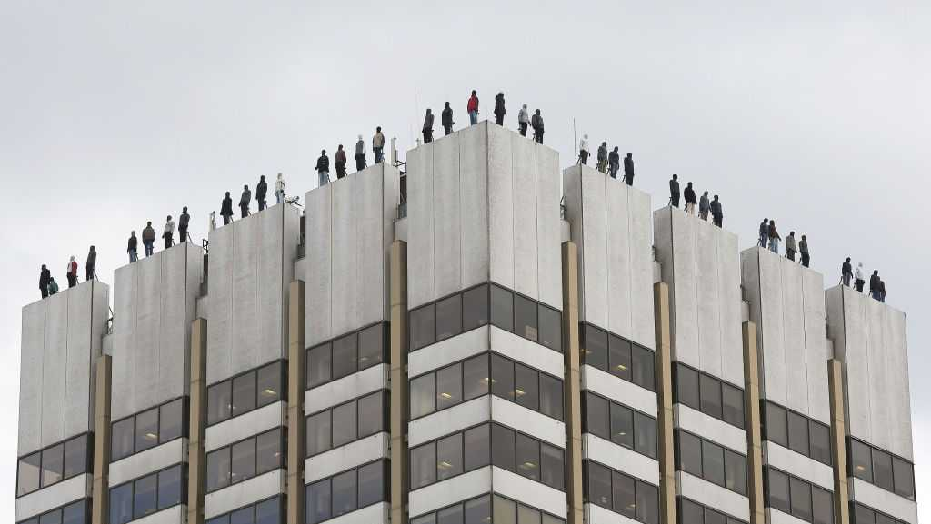 The sculptures of 84 men, made by American artist Mark Jenkins and his collaborator, Sandra Fernandez, part of Project 84, a campaign to raise awareness of the fact that 84 men take their own lives every week in the UK, ontop of London Television Centre after the installation was unveiled.