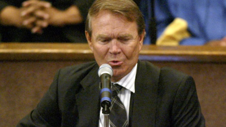 Glen Campbell performs during the funeral of Ray Charles, Los Angeles, California, photo on black