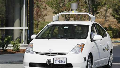 In this Sept. 25, 2012, file photo, California Gov. Edmund G Brown Jr., front left, rides in a driverless car to a ceremony in Mountain View, Calif., for the signing of a bill allowing for testing of driverless vehicles in the state.